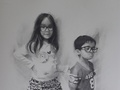 Graphite drawing of two children