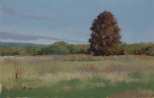 Plein air painting featuring a solitary tree with fall foliage set against the backdrop of the Blue Ridge Mountains