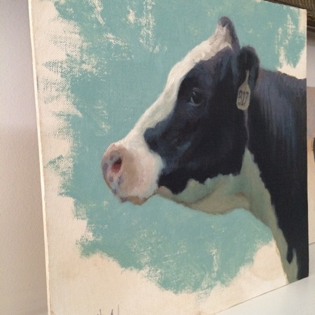 A portrait of a holstein cow