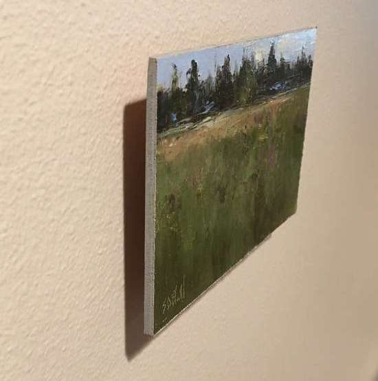 A painting panel offset from a wall creates a drop shadow.