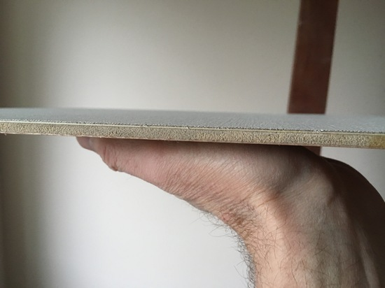 Photo showing the clean straight edge of a painting panel