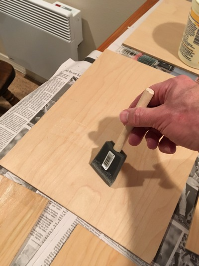Applying size to a painting panel