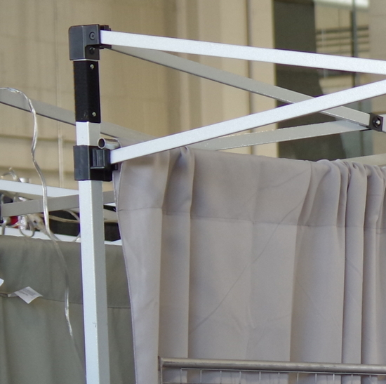 A hanging method for drapes at an art fair booth